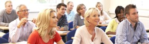 adults learning a language in a classroom