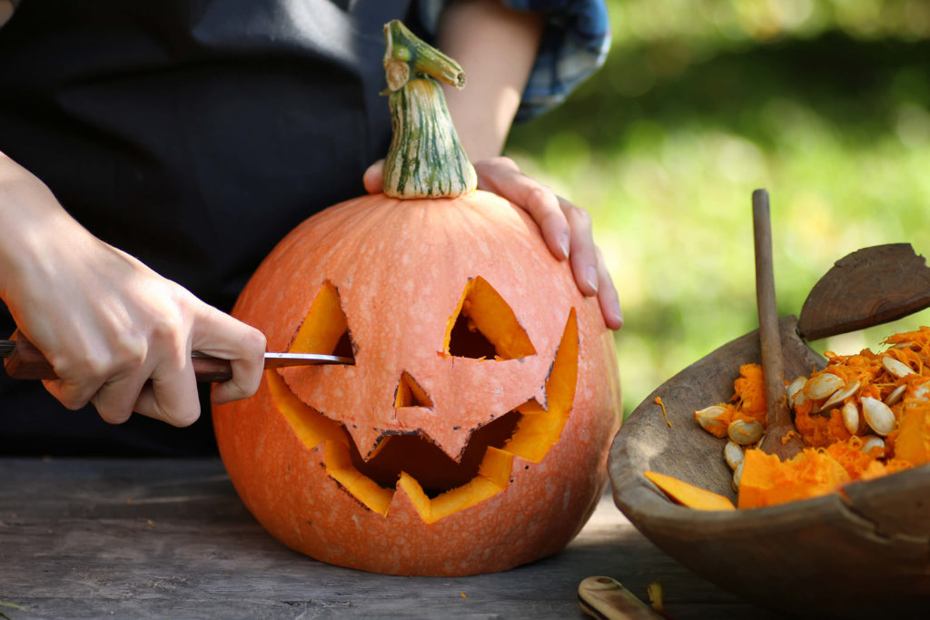 Halloween traditions around the world. Pumpkin being carved