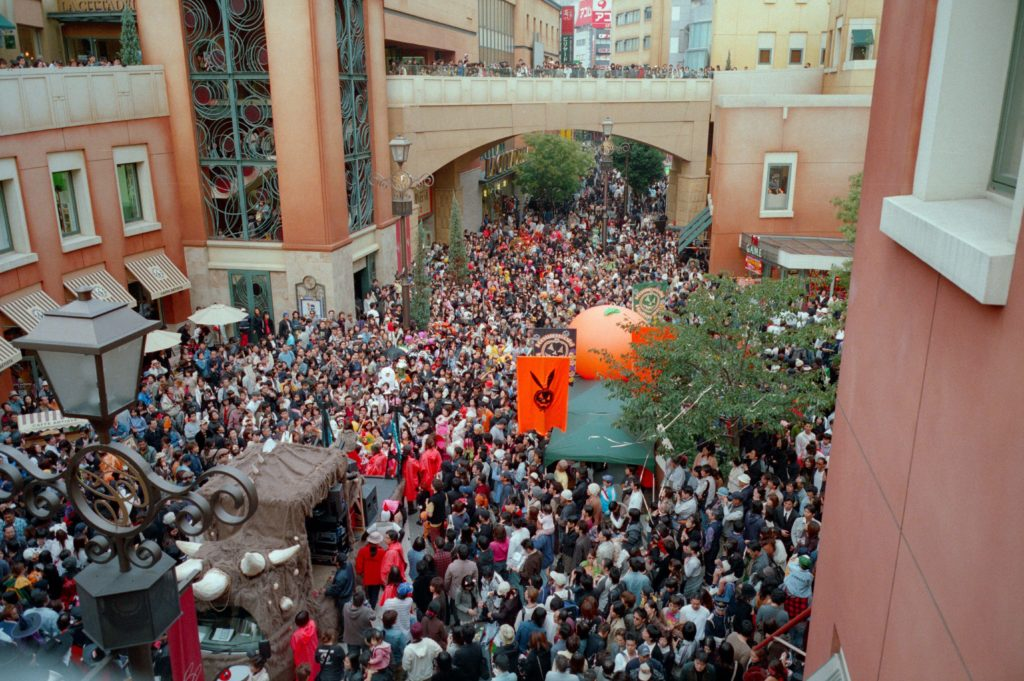 Halloween traditions in Japan. Visitors line the streets for Kawasaki Halloween Parade